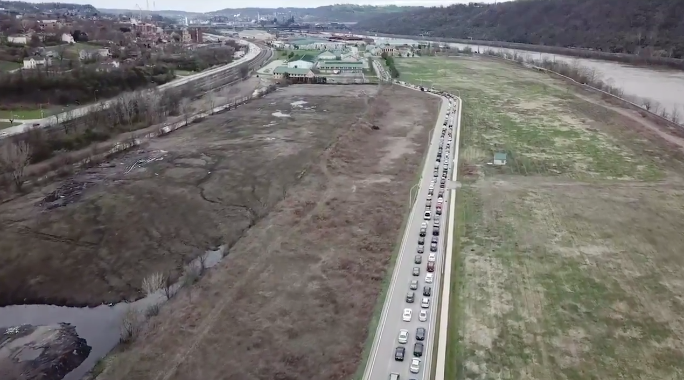 still from a video of miles of cars in Duquesne, Pennsylvania, waiting for food from a food bank