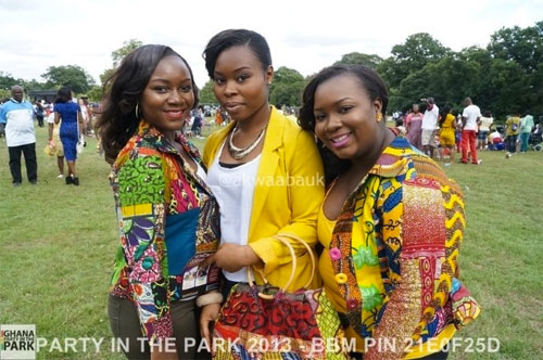 image: three young beautiful women in red green and yellow clothes | caption: PARTY IN THE PARK 2013