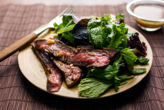 image of cooked red meat flavored or garnished with mint | Tacky Harper's Cryptic Clues