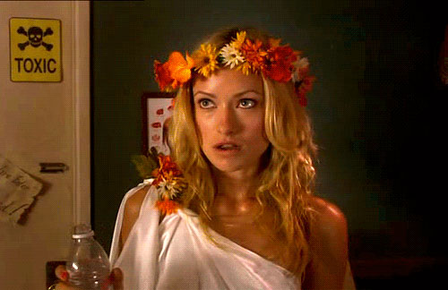 a white sorority girl with a toga and flower garland | Tacky Harper's Cryptic Clues